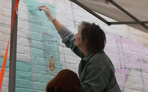 CFTC Volunteer Painting Mural